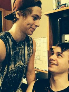 Luke Hemmings and Michael Clifford Luke's like do I look cute and michael's like what are you doing?