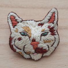 Stitch a cat face.
