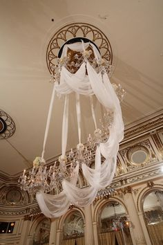 David Tutera = add to our chandeliers for suspended drama