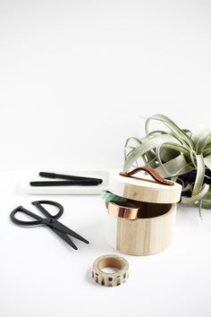 Make these DIY leather box handles out of thrifted leather belts to turn a plain storage box into a modern statement piece.