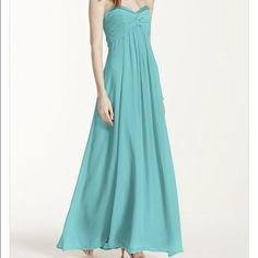 🚨PRICE FIRM🚨PROM DRESS/EVENING GOWN Long chiffon dress Aqua color. Rhinestones in the top, zipper in the back. Perfect conditions. Used once for a wedding. Size:2. Had been sent to dry cleaning. Color name: Pool from Davids Bridal. Comes with special wrap against humidity. Comes with dust cover. 🚫No trades🚫✔️ONLY SERIOUS BUYERS✔️🐶KIKI IS A TOP SELLER, READ LOVE NOTES🐶 Will videotape and take pictures of dress before sending it. David's Bridal Dresses Prom