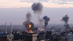 Columns of smoke rise following an Israeli air strike in Gaza City Nov. 14, 2012. / AP PHOTO