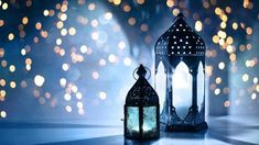 Couple of glowing Moroccan ornamental lanterns on the table. Greeting card, invitation for Muslim holy month Ramadan Kareem. Festive blue night background with glittering golden bokeh lights. Eid Background, Night Background, Wallpaper Ramadhan, Feng Shui, Ramadan Lantern, Grands Vases, Bokeh Lights, Ramadan Decorations, Islamic Pictures