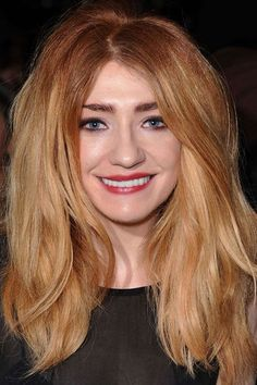 Dip dyed-tips don't have to be all about the blonde. Make like Nicola Roberts with fiery roots through to dreamy blushing tips.