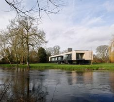 Narula House raised on stilts over River Thames flood zone British Architecture, London Architecture, Modern Architecture, Raised House, Sweet Chestnut, Solar Shades, Flood Zone, River Thames, House Extensions