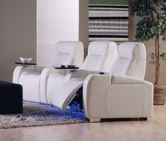 This home theater set features cup holders, LED lights and tray tables.