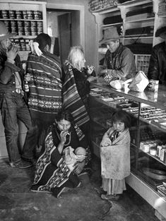 From the original 1948 LIFE Magazine story- Navajos trading at the store on the reservation. Leonard McCombe—The LIFE Images Collection/Getty Images Native American Photos, Native American History, Grazing Animals, Navajo Women, Navajo People, Silver Shirt, Navajo Nation, Old West, Old Photos