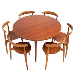 Hans Wegner 'heart' Dining Set In Rare Teak And Oak Combi | From a unique collection of antique and modern dining room sets at http://www.1stdibs.com/furniture/tables/dining-room-sets/