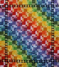 Disappearing Rainbow Quilt.  An easy quilt with astonishing results. The nine-patch blocks constructed in rainbow colored fabrics will disappear when assembling this quilt.    $10.00