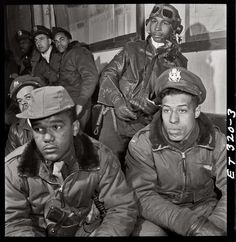 "332nd Fighter Group airmen at a briefing in Ramitelli, Italy. March 1945. Foreground: Emile G. Clifton of San Francisco and Richard S. ""Rip"" Harder of Brooklyn."