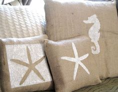 Hand painted burlap pillows- good idea! I can't find it on her blog, but I can do this. I just need to go to the Goodwill and find a neat cable knit sweater to turn into a pillow.