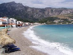 Kokkari beach | travelovergreece Samos, Greece Travel, Greek, Island, Water, Summer, Outdoor, Beaches, Board