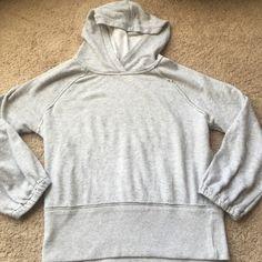 Free People light grey pull over hoodie Free People Light grey pull over hoodie great condition Free People Tops Sweatshirts & Hoodies