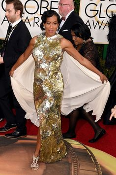 Regina King looked as elegant as ever in a caped gold gown by Krikor Jabotian at Sunday's Golden Globes red carpet.