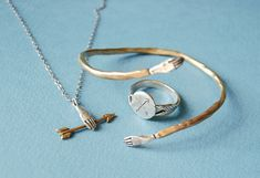 jewelry by kaye blegvad / love those tiny metal hands