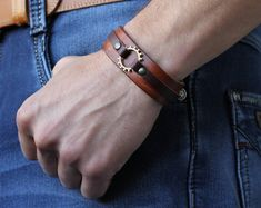 Items similar to Steampunk brown leather bracelet, steam punk antique leather cuff, unisex wheel wristband, brutal style LARP jewelry on Etsy Braided Bracelets, Cord Bracelets, Bracelets For Men, Fashion Bracelets, Fashion Jewelry, Leather Bracelets, Diy Jewelry, Handmade Jewelry, Leather Accessories