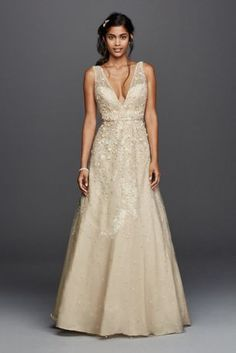 The plunging V-neckline and V-back on this tulle A-line wedding dress make  a chic and sexy statement 9af7c99d93aa