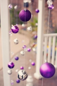 In Red, green, gold, silver... Christmas colors!!!  YES; using fishing line, & securing it taught at both top AND bottom so it looks as tho the ornaments are suspended in air on your front porch!!! PERFECT!