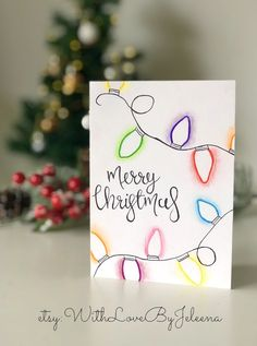 Handmade Christmas cards with Christmas lights and calligraphy. You can purchase them on Etsy at the link below! Handmade Christmas cards with Christmas lights and calligraphy. You can purchase them on Etsy at the link below! Diy Holiday Cards, Custom Christmas Cards, Simple Christmas Cards, Handmade Christmas Tree, Christmas Card Crafts, Homemade Christmas Cards, Christmas Tree Cards, Xmas Cards, Diy Cards
