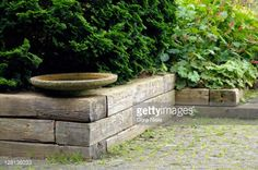Bildbanksbilder : Small concrete water feature on raised bed of railway sleepers, Mien Ruys Garden, Holland, September. Part of a series, image 38 of 47