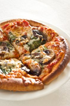 Individual Pizzas with Mushrooms and Spinach - Click for Recipe