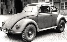 "redhousecanada: "" 1943 WW2 Beetle type 87 in wartime livery. It has the 4x4 drivetrain of the Schwimmwagen, but with a KDF sedan body. Also known as a Kommandeurwagen. "" The early beetles did it all."