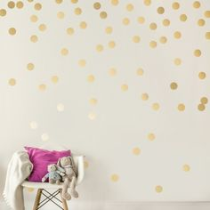 Gold polka-dot wall decals that'll safely peel away from your wall.