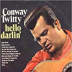 "Conway Twitty - ""Hello Darlin' "" (I remember my PaPa dancing with my Namaw in the kitchen every time this came on)   ;)"