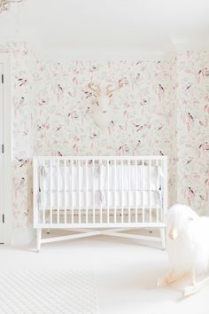 This wallpaper in this baby nursery is everything! Photography: Elza Photographie - www.elzaphotographie.com   Read More on SMP: http://www.stylemepretty.com/living/2016/12/16/the-most-magical-nurseries-of-2016/