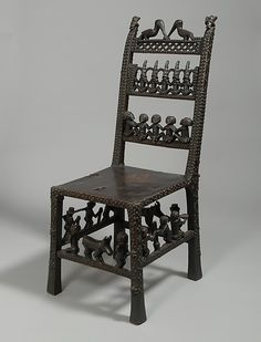 Africa | Chair: Rungs with Figurative Scenes (Ngundja) | 19th–20th century |  Angola,  Chokwe peoples  | Wood, brass tacks, leather
