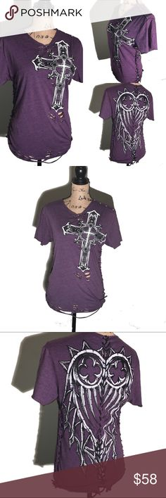 ✂️ Upcycled revamped purple REDEMPTION tshirt This purple REDEMPTION tshirt has been completely revamped. Knots down each side, corset with strings down the back and cut/weave at the top. has been distressed near the bottom. Perfect size, not too tight and not too loose. Will fit a size medium.   #affliction #daytrip #redemption #buckle #bke #embellished #archaic #corset #weave #upcycled #revamped #redone #cross #purple #diy #diyfashion #danamariedior #revampdlife reVamp'D Tops Tees - Short…