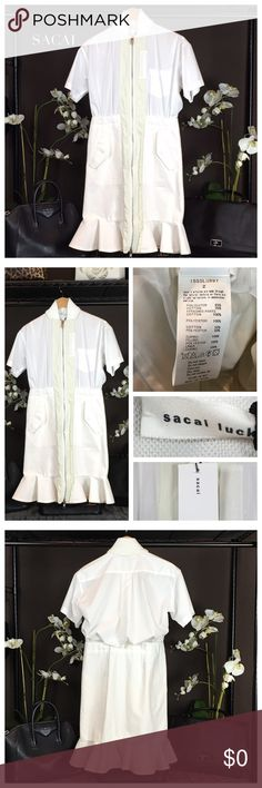 Sacai White Short Sleeve Jacket Dress You can't go wrong with this stylish jacket dress by SACAI. Can be style up or down for a classic look. Size: 2 Material: 65% Polyester 35% Cotton Condition: Pristine-NWT. Tags do not list retail price as this is a boutique item. Sacai Dresses