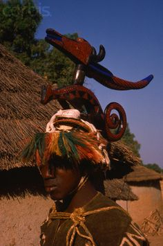 Africa | A Bambara woman wears an oryx mask which is believed to bring luck to agricultural crops. Mali.| Image and caption © Charles & Josette Lenars