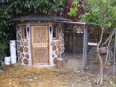 A chicken... castle? It's a very pretty chicken coop I love the cord-wood construction. If I were to build a chicken house like this I don't think I'd go round though, just not enough places to put perches, nesting boxes, feeders, and waters.
