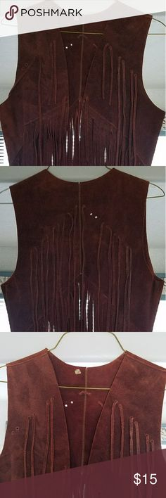 "Vintage 60's leather long fringed vest Vintage 60's leather fringed vest. UGC , size M , note : missing 2 small leather strips noted in third pic can be easily fixed. Length from shoulder of vest to bottom of fringe is 31"". Jackets & Coats Vests"