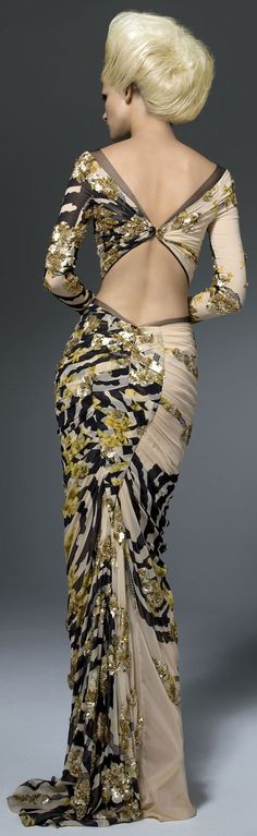 Most of can't wear anything like this. But we can appreciate the artistry of the fabric. Show some skin-Versace nice evening dress to show women's charm