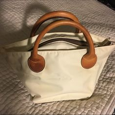 Herve Chaplier cream nano handbag Herve Chaplier cream nano /mini handbag with leather handles and bottom. okay condition....some stains on fabric ...from age & wear. as such selling for extremely aggressive price. herve chaplier Bags