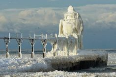 This is the St. Joseph Lighthouse on Lake Michigan. Gale force winds splashed water all over it and it became encased in ice! Thank you for this miracle, Winter Storm Hercules.