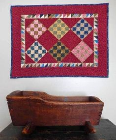 Old wooden Doll Cradle and a great Doll Sized Quilt.