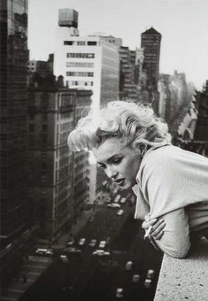 NYC. Marilyn Monroe in The Ambassador Hotel's terrace, Park Avenue and 51th St., 1955  by Ed Fergeinst.