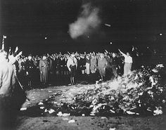 Nazi salutes and anthems accompany the smouldering pile - book-burning gathering, May 10, 1933  This shows how Hitler knew the power of words and how they would give people hope. thats why he buned them.