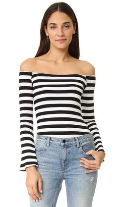 ¡Cómpralo ya!. Torn By Ronny Kobo Kylie Sweater - Multi Stripe. Two tone stripes bring graphic impact to this ribbed, formfitting Torn by Ronny Kobo top. Off shoulder neckline. Bell sleeves. Fabric: Ribbed fine knit. 92% rayon/8% spandex. Dry clean. Made in the USA. Measurements Length: 19in / 48cm, from center back Measurements from size S. Available sizes: L,M,S,XS , tophombrosdescubiertos, sinhombros, offshoulders, offtheshoulder, coldshoulder, off-the-shouldertop, schulterfreiestop…