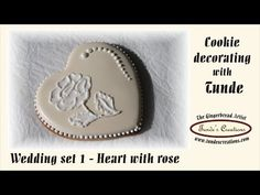 Not brush embroidery--she uses watery icing (I think) to paint in the rose details. Beautiful!