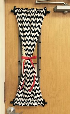Curtain for classroom door. Supplies: Command Hooks, Dowel Rod, Fabric, and Ribbon