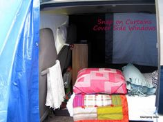 Here is a view inside the van from the bathroom. The bed is in the sleeping position. You can see I still have plenty of room to access the bathroom. The curtains also snap on. I roll them up and tuck them behind the rear seat belts when I am not sleeping, so the rear windows always have curtains up. You can also see the front privacy curtain hanging in front of the seats. It snaps on and off easily as well.