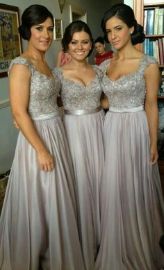 Gorgeous elegant bridesmaid dresses love the color! Custom papercut invitations and ketubah at www.hebrica.comlove the style, diff color... rose gold, champagne pink?