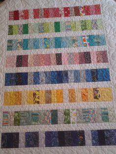 Rainbow strip quilt by Nancy Smith