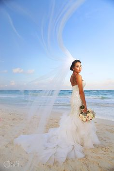 Bridal beach portrait at a destination wedding at the Akiin Beach Club in Tulum. Mexico wedding photographers Del Sol Photography.