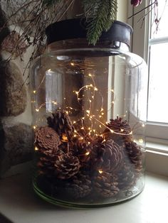 Perfect little Christmas display for the fireplace. May even spray paint some of the pine cones gold.
