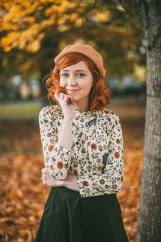 Floral print blouse + green skirt